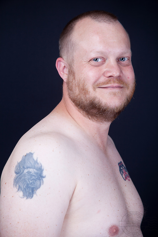 Danish male with celtic/viking and inspired tattoos. On his left shoulder he has a celtic cross. On the left forarm he has two vikinghelmets. On the right forarm he has a beautifull picture of Odin with his two ravens. On the left side of his chest he has  a inca-inspired cat. On the left shoulder is his first tattoo - a lionhead.<br /> The celtic/viking tattoos are all done at Miss Roxy tattoo studio