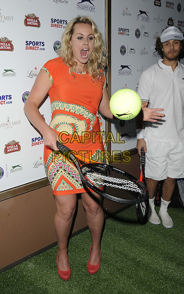 Chimene &quot;Chemmy&quot; Mary Alcott<br /> attended the Slazenger Wimbledon Party, Whisky Mist bar &amp; nightclub, Hertford St., London, England, UK, 27th June 2013.<br /> full length orange dress print shoes coral tennis ball racquet yellow <br /> CAP/CAN<br /> &copy;Can Nguyen/Capital Pictures