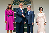 US President Donald J. Trump (C-L) and First Lady Melania Trump (L) welcome Korean President Moon Jae-in (C-R) and Mrs. Kim Jung-sook (R) to the Colonnade of the White House in Washington, DC, USA, 11 April 2019. President Moon is expected to ask President Trump to reduce sanctions on North Korea in an attempt to jump start nuclear negotiations between North Korea and the US.<br /> Credit: Jim LoScalzo / Pool via CNP