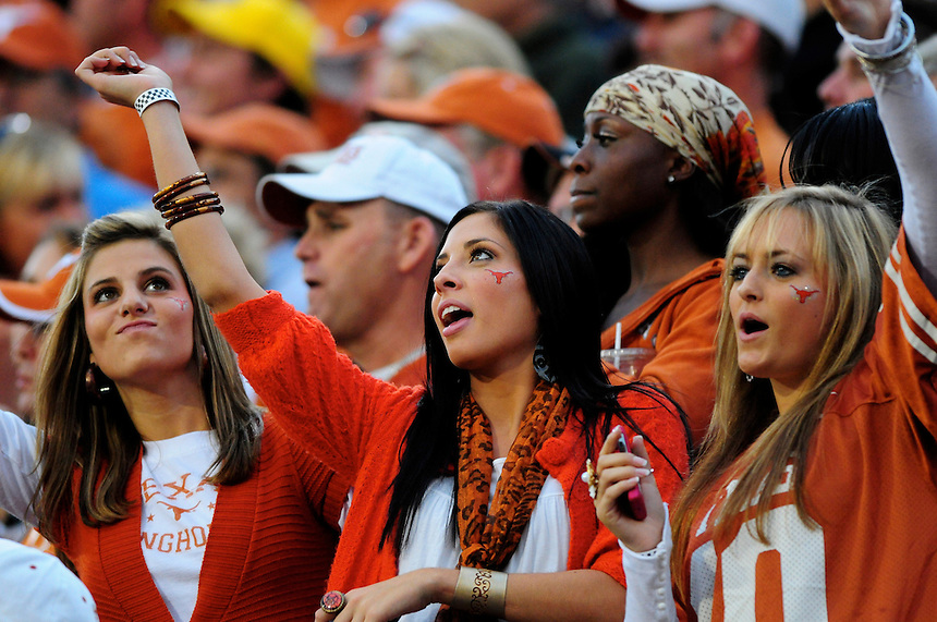 04 October 2008: A trio of female Texas fans during a game against Colorado. The Texas Longhorns defeated the Colorado Buffaloes 38-14 at Folsom Field in Boulder, Colorado. For Editorial Use Only