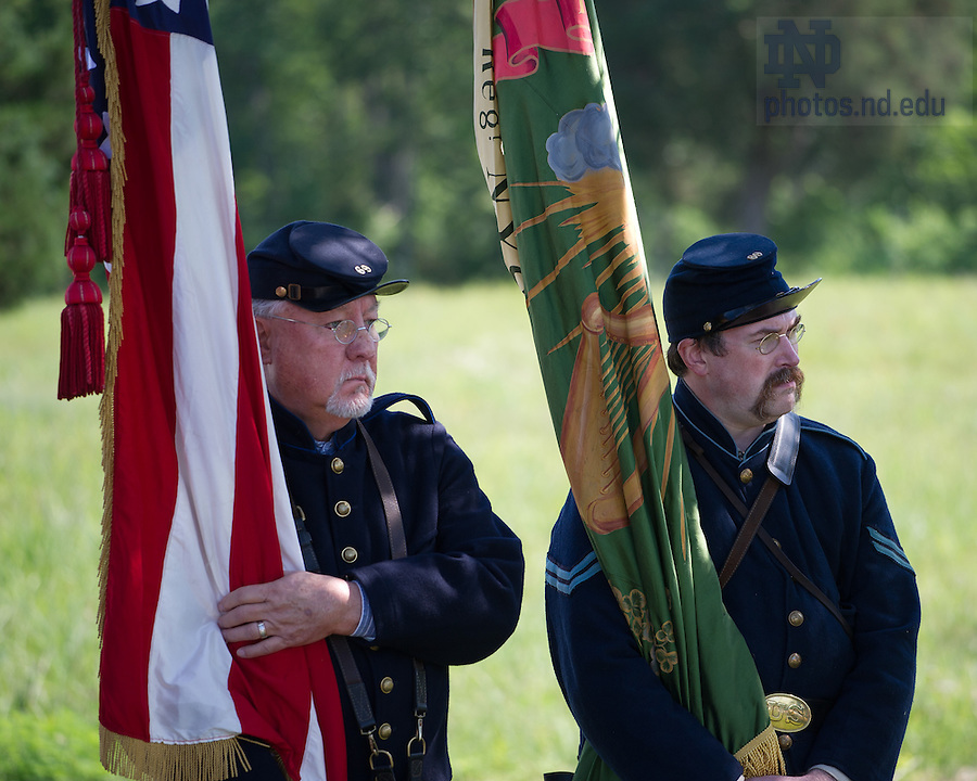 "June 22, 2013; Pat Vaughan, left and Gary Ryan of the 69th New York Historical Association, ""The Irish Brigade"" watch the Mass and blessing of the Statue of Rev. William Corby, C.S.C. at Gettysburg National Military Park.<br /> <br /> Photo by Matt Cashore/University of Notre Dame"