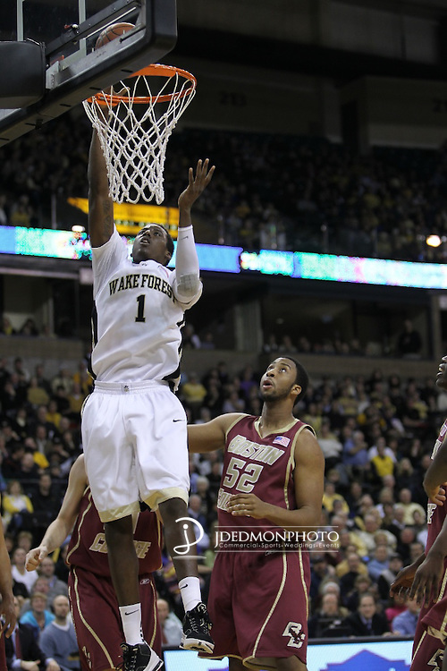 07 March 2009: In game action at Joel Coliseum Winston Salem North Carolina as Wake Forest forward Al-Farouq Aminu lays it in past Boston College center Josh Southern. Wake wins 92-85 over the Eagles..Mandatory Credit:Jim Dedmon/ Southcreek Global