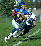 Kyle Young quarterback for Dakota State University looks upfield while being run down by Colton Clark of SD Tech in the first quarter of their game Saturday, October 20, 2007 in Madison, SD. (photo by Ty Carlson/Inertia)
