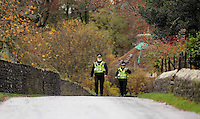 Pictured: Police officers walk on the road by river Ogmore near Stormy Down, Wales, UK. Tuesday 22 November 2016<br />Re: The search has resumed for Russell Sherwood, 69, who went missing in river Ogmore, Bridgend County on Sunday.<br />Sherwood, of Cilfrew, Neath, was heading for Ewenny in the Vale of Glamorgan during heavy rain in the morning but never arrived.<br />He disappeared at Stormy Down and car parts were found on the river bank.<br />South Wales Police have confirmed registration plates recovered from a bumper match Mr Sherwood's car.