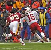 Washington Redskins defensive end Marco Coleman (99) sacks Arizona Cardinals quarterback Jake Plummer (16) for a loss of five yards in first quarter action of the game in Landover, Maryland on January 6, 2002. The Redskins won the game 20 - 17.<br /> Credit: Ron Sachs / CNP
