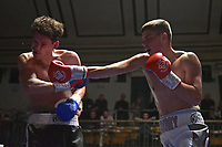 Terry Conroy (white shorts) defeats Scott Hillman during a Boxing Show at York Hall on 30th November 2018