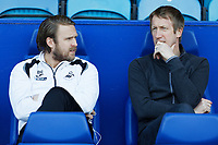 (L-R) Bjorn Hamberg, assistant coach for Swansea and Swansea City manager Graham Potter sit on the bench during the Sky Bet Championship match between Sheffield Wednesday and Swansea City at Hillsborough Stadium, Sheffield, England, UK. Saturday 23 February 2019