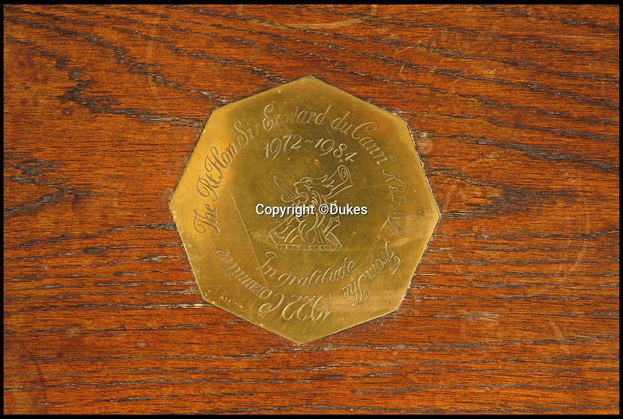 BNPS.co.uk (01202 558833)<br /> Pic: Dukes/BNPS<br /> <br /> An octagonal brass plaque on an oak 'joined' stall, estimated £200.<br /> <br /> The collection of an influential politician who helped bring Thatcher to power is going under the hammer and expected to fetch more than £86,000.<br /> <br /> More than 100 items owned by the late Sir Edward du Cann, including a rare maquette of Winston Churchill worth £50,000, have been put up for sale by his family with Duke's of Dorchester in Dorset following his death last year.<br /> <br /> Sir Edward was an MP for 31 years and the longest serving chairman of the powerful 1922 committee, where he was instrumental in bringing Margaret Thatcher to power in 1979, and his name was never far from the front pages of the national newspapers in the 1960s and 70s.<br /> <br /> Among the items being sold are several bronze sculptures of Prime Ministers Winston Churchill, Margaret Thatcher and Clement Atlee.<br /> <br /> The collection will be sold in the Dorchester saleroom on September 6.