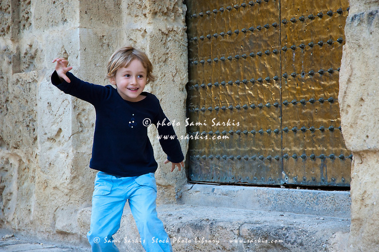 Little girl playing outside the Catedral de Cordoba, a former medieval mosque in Cordoba, Andalusia, Spain.