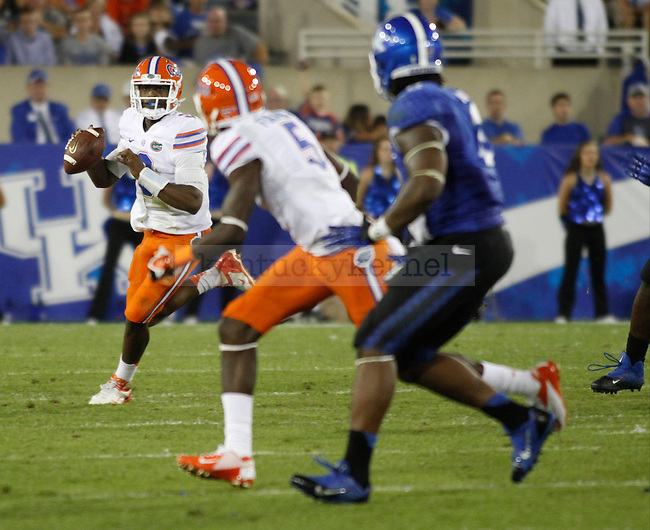 Florida Gators quarterback Tyler Murphy (3) runs downfield during the second half of the UK football game against Florida at Commonwealth Stadium in Lexington, Ky., on Saturday, September 28, 2013. Photo by Eleanor Hasken | Staff
