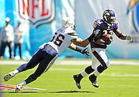 Sep. 20, 2009; San Diego, CA, USA; San Diego Chargers linebacker (56) Shawne Merriman tackles Baltimore Ravens fullback (33) LeRon McClain at Qualcomm Stadium in San Diego. Baltimore defeated San Diego 31-26. Mandatory Credit: Mark J. Rebilas-