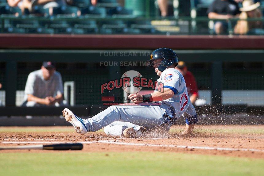 Mesa Solar Sox shortstop Nico Hoerner (17), of the Chicago Cubs organization, slides across home plate during an Arizona Fall League game against the Scottsdale Scorpions at Scottsdale Stadium on November 2, 2018 in Scottsdale, Arizona. The shortened seven-inning game ended in a 1-1 tie. (Zachary Lucy/Four Seam Images)
