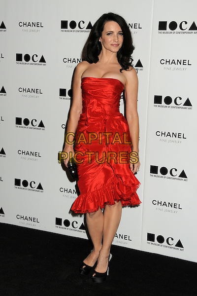 "KRISTIN DAVIS .attending MOCA's Annual Gala, ""The Artist's Museum Happening"", Sponsored by Chanel Fine Jewelry, held at MOCA Grand Avenue (Museum Of Contemporary Art) in Los Angeles, California, USA, November 13th 2010. .full length strapless red dress ruffles ruffle peep toe shoes platform silk satin black clutch bag .CAP/ADM/BP.©Byron Purvis/AdMedia/Capital Pictures."