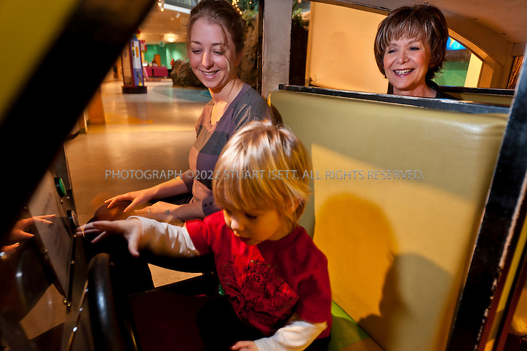 2/13/2012--Seattle, WA, USA..Karen Eddinger (right, age not given) and her daughter Dorey Miller (35) and grandson Sebastian (2) visiting The Children's Museum at Seattle Center in Seattle, WASH. Eddinger used a Groupon discount coupon for her family to visit the museum and save on admission. Karen Eddinger cannot say no to a deal and hence winds up doing things over and over again that she didn't necessarily want to do in the first place. ..©2012 Stuart Isett. All rights reserved.
