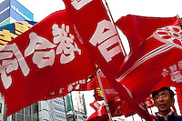 Red flags carried by Marxists and union activists surround Yasahiro Tanaka, President of Doro Chiba railway Union, while marching in a demonstration at The National Worker`s Rally organised by Marxist groups and Doro Chiba labour union in Tokyo, Japan, Sunday November 1st 2009