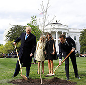 U.S. President Donald Trump with France's president Emmanuel Macron and First Ladies Melania Trump and Brigitte Macron plant a tree, a gift from the President and Mrs. Macron, on the South Lawn of the White House in Washington, D.C., U.S., on Monday, April 23, 2018. As Macron arrives for the first state visit of Trumpís presidency, the U.S. leader is threatening to upend the global trading system with tariffs on China, maybe Europe too. Photographer: Yuri Gripas/Bloomberg<br /> Credit: Yuri Gripas / Pool via CNP