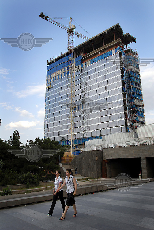 A new hotel and apartment block being built in central Tbilisi. The original hotel on this site had been turned into a refugee complex to house those fleeing the violence in Abkhazia, in 1992. The construction was near completion just in time for the next refugee crisis, those from the South Ossetian conflict.