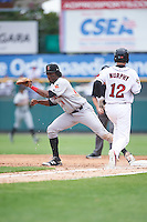 Indianapolis Indians first baseman Josh Bell (18) touches the bag to force out John Ryan Murphy (12) during a game against the Rochester Red Wings on May 26, 2016 at Frontier Field in Rochester, New York.  Indianapolis defeated Rochester 5-2.  (Mike Janes/Four Seam Images)
