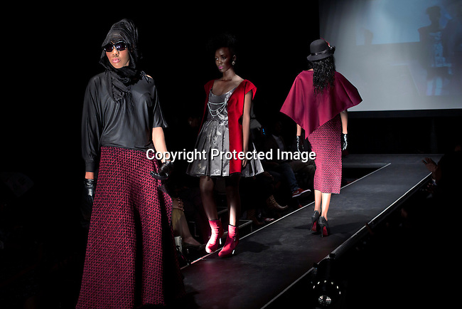 SOWETO, SOUTH AFRICA MAY 29: Models for the designer Limba by Mbali walks with garments during a fashion show at Soweto Fashion Week on May 29, 2014 at the Soweto Theatre in the Jabulani section of Soweto, South Africa. Local emerging designers showed their collections during the three-day event held at the theatre. Founded in 2012, Soweto fashion week gives a platform to local designers, models and artists. (Photo by: Per-Anders Pettersson)