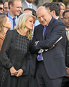 Counselor to the President Kellyanne Conway, left, and Director of the National Economic Council and chief economic advisor Gary Cohn, right, speak prior to the arrival of United States President Donald J. Trump and first lady Melania Trump who will lead a moment of silence in remembrance of those lost on September 11, 2001 on the South Lawn of the White House in Washington, DC on Monday, September 11, 2017.<br /> Credit: Ron Sachs / CNP