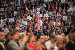 The audience cheers as former President Bill Clinton speaks at the Democratic National Convention on Wednesday, September 5, 2012 in Charlotte, NC.