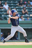 Designated hitter Shane Hoelscher (22) of the Asheville Tourists bats in a game against the Greenville Drive on Thursday, August 13, 2015, at Fluor Field at the West End in Greenville, South Carolina. Asheville won, 8-1. (Tom Priddy/Four Seam Images)