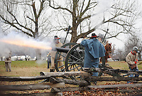 NWA Media/ANDY SHUPE - Volunteers set of a cannon while taking part in a re-enactment of the Battle of Prairie Grove Saturday, Dec. 6, 2014, at Battlefield State Park in Prairie Grove. This is the 152nd anniversary of the battle which took place Dec. 7, 1862 between 12,000 Confederate and 10,000 Federal soldiers. Visit nwamedia.photoshelter.com to see more photographs from the battle.