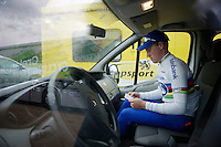 Superprestige Zonhoven 2013<br /> <br /> race winner (and U23 world champion) Mike Teunissen (NLD) waiting in a van checking his UCI-license before doping controle (in the yellow truck next to him)
