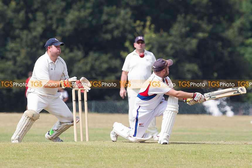 Mark Speller of Hornchurch tries to help the ball to leg, and fortunately gets nothing on it as Keeper Stanbridge pounces for Havering - atte - Bower - Hornchurch Athletic CC 3rd XI vs Havering-atte-Bower CC 3rd XI - Mid-Essex League Cricket at Raphael Park - 12/07/14 - MANDATORY CREDIT: Ray Lawrence/TGSPHOTO - Self billing applies where appropriate - contact@tgsphoto.co.uk - NO UNPAID USE