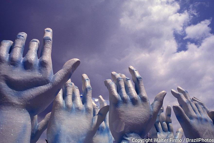 Sculptures of hands. Samba School Parade, Rio de Janeiro Carnival, Brazil. Allegory, faith, popular culture, hands up to heaven.