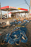 Mar. 13, 2011 - Ibaraki, Japan - A gas station is shown destroyed in Oarai two days after the 8.9 magnitude earthquake struck followed by a tsunami that hit the north-eastern region. The death toll is currently unknown with casualties that may run well into the thousands.