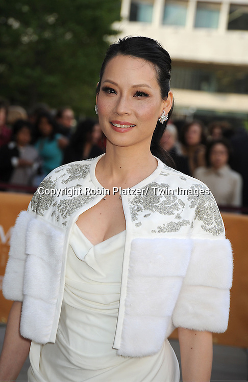 Lucy Liu in Vivienne Westwood white dress attends the American Ballet Theatre's Spring Gala on May 13, 2013 at The Metropolitan Opera House in New York City.