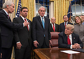 United States President Donald J. Trump listens as US Senator Rob Portman (Republican of Ohio) makes remarks prior to his signing the bipartisan Interdict Act, a bill to stop the flow of opioids into the United States in the Oval Office of the White House in Washington, DC on Wednesday, January 10, 2018.  The Interdict Act will provide Customs and Border Protection agents with the latest screening technology devices used to secure our border from illicit materials, specifically fentanyl, a powerful opioid that is destroying lives across the country. <br /> Credit: Ron Sachs / Pool via CNP