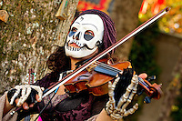 A costumed performer plays the violin at the annual Carolina Renaissance Festival in November 2011. The annual Renaissance Festival and Fair takes place each October and November in Huntersville, NC, near Charlotte, NC.