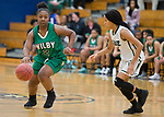 WATERBURY, CT-120818JS12- Wilby's Jonaria Garcia (2) tries to get past Chase Collegiate's Loren Tuck (3) during their Waterbury girls basketball jamboree game Saturday at Kennedy High School. <br /> Jim Shannon Republican American