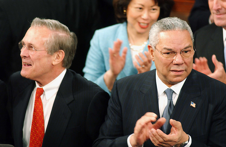1/28/03.STATE OF THE UNION ADDRESS--Defense Secretary Donald Rumsfeld and Secretary of State Colin Powell before President George W. Bush's State of the Union address at the U.S. Capitol..CONGRESSIONAL QUARTERLY PHOTO BY SCOTT J. FERRELL