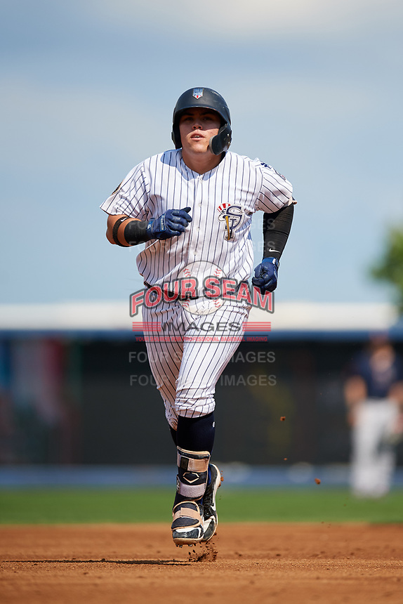 Staten Island Yankees third baseman Andres Chaparro (26) rounds the bases after hitting a home run in the bottom of the third inning during a game against the Lowell Spinners on August 22, 2018 at Richmond County Bank Ballpark in Staten Island, New York.  Staten Island defeated Lowell 10-4.  (Mike Janes/Four Seam Images)