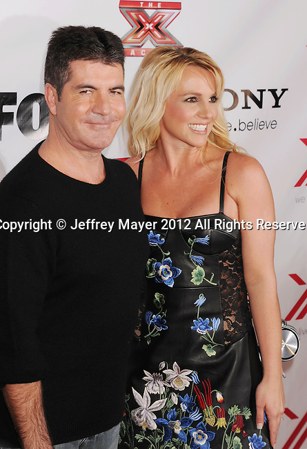 LOS ANGELES, CA - DECEMBER 06: Simon Cowell and Britney Spears arrive at the 'The X Factor' Viewing Party Sponsored By Sony X Headphones at Mixology101 & Planet Dailies on December 6, 2012 in Los Angeles, California.