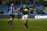 Millwall's Murray Wallace skilfully controls the ball as Adam Reach of Sheffield Wednesday looks on during Millwall vs Sheffield Wednesday, Sky Bet EFL Championship Football at The Den on 12th February 2019