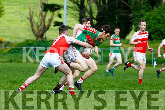 Donal Maher Kilcummin is tackled by Dingles Tom O'Sullivan during their SFC relegation play off in Killorglin on Sunday