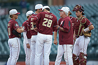 Florida State Seminoles head coach Mike Martin holds a meeting on the mound during the game against the Notre Dame Fighting Irish in Game Four of the 2017 ACC Baseball Championship at Louisville Slugger Field on May 24, 2017 in Louisville, Kentucky. The Seminoles walked-off the Fighting Irish 5-3 in 12 innings. (Brian Westerholt/Four Seam Images)
