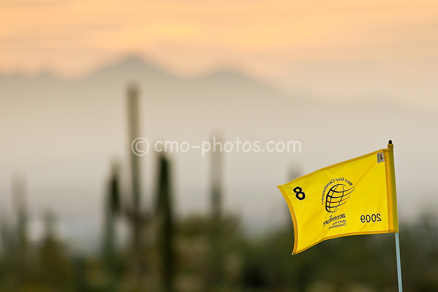 Feb 23, 2009; Marana, AZ, USA; The flag on the 8th green waves as the sun sets during the Monday practice round prior to the World Golf Championships-Accenture Match Play Championship at the Ritz-Carlton Golf Club, Dove Mountain.