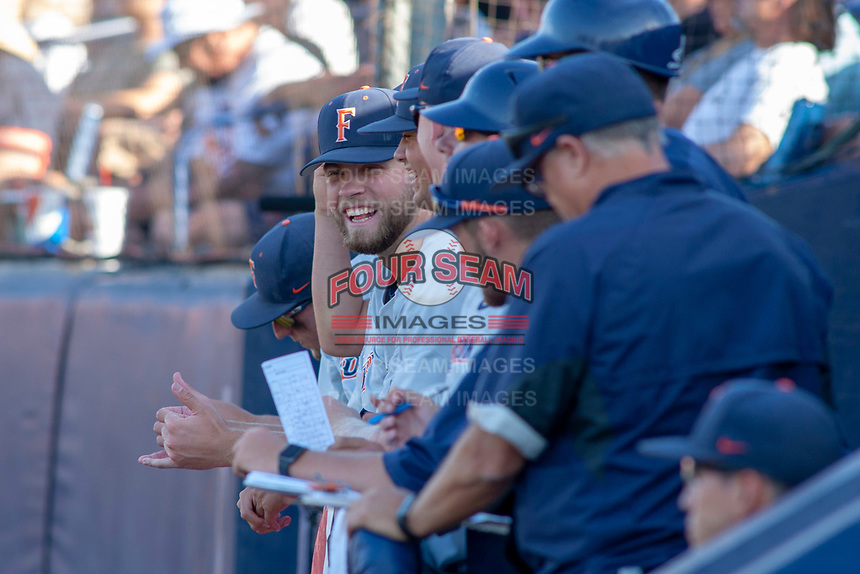 Cal State Fullerton Titans watch from the dugout during the game against the University of Washington Huskies at Goodwin Field on June 09, 2018 in Fullerton, California. The Cal State Fullerton Titans defeated the University of Washington Huskies 5-2. (Donn Parris/Four Seam Images)