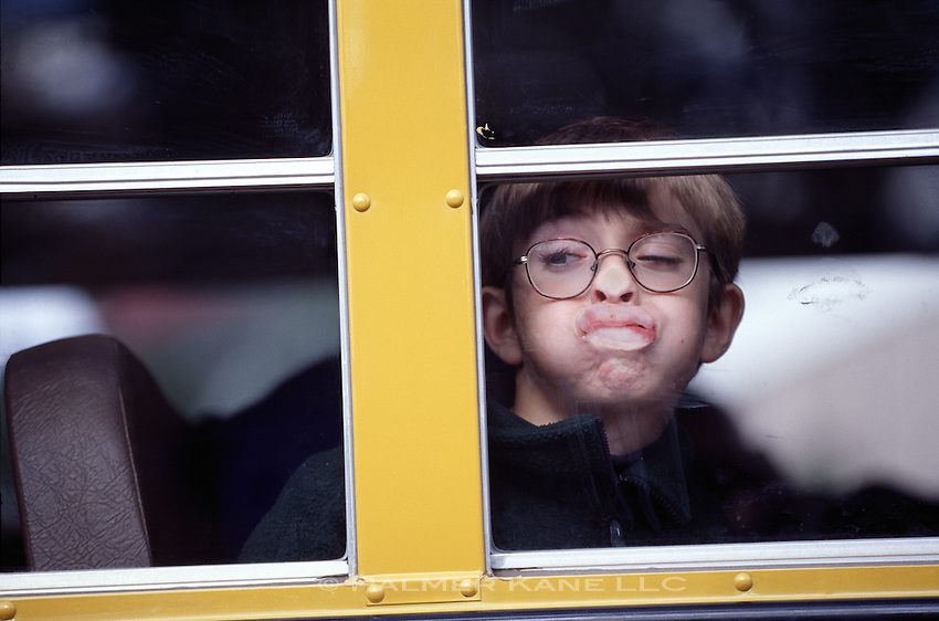 BOY MAKES FACE ON SCHOOL BUS