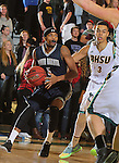 SPEARFISH, SD - DECEMBER 3, 2015 -- Jaisean Jackson #5 drives past Patrick Mendes #3 of Black Hills state during their college basketball game Saturday at the Donald E. Young Center in Spearfish, S.D. (Photo by Dick Carlson/Inertia)