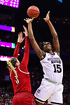 COLUMBUS, OH - MARCH 30: Teaira McCowan #15 of the Mississippi State Bulldogs  shoots over Sam Fuehring #3 of the Louisville Cardinals during a semifinal game of the 2018 NCAA Division I Women's Basketball Final Four at Nationwide Arena in Columbus, Ohio. (Photo by Ben Solomon/NCAA Photos via Getty Images)