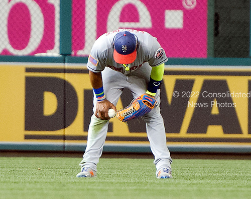 New York Mets left fielder Yoenis Cespedes (52) looks down after trapping the ball that resulted in the Washington Nationals scoring the winning run in the bottom of the ninth inning  at Nationals Park in Washington, D.C. on Monday, July 3, 2017.  The Nationals won the game 3 - 2.<br /> Credit: Ron Sachs / CNP<br /> (RESTRICTION: NO New York or New Jersey Newspapers or newspapers within a 75 mile radius of New York City)