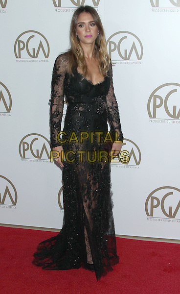 Jessica Alba.At the 24th Annual Producers Guild Awards held at the Beverly Hilton Hotel, Beverly Hills, California, USA,.26th January 2013..PGAs PGA arrivals full length black lace dress long sleeve maxi purple clutch bag sheer see thru though .CAP/ADM/RE.©Russ Elliot/AdMedia/Capital Pictures.
