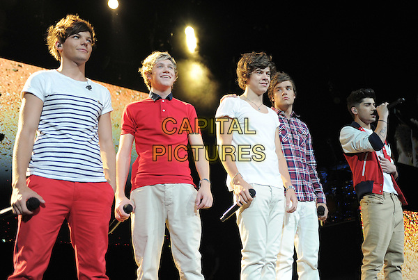 One Direction performs live during their US Summer Tour 2012 at The Honda Center in Anaheim, California, USA..June 17th, 2012 .1D on stage in concert live gig performance music half length white top blue check shirt striped stripes singing jacket Niall Horan, Zayn Malik, Liam Payne, Harry Styles, Louis Tomlinson.CAP/RKE/DVS.©DVS/RockinExposures/Capital Pictures.