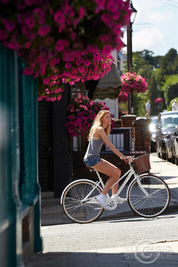 Zoe riding white Charge Decanter bicycle .   Sunninghill, Berks.    July   2013.      pic copyright Steve Behr / Stockfile